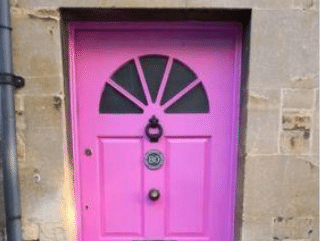 Pink front door banned by council